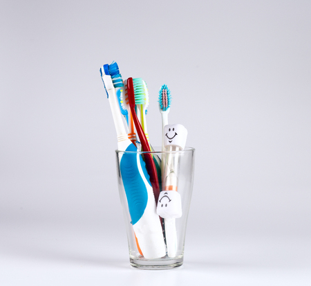 new tooth brush on a white background with sandglass time to change Stock Photo