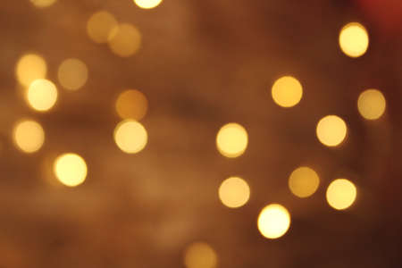 Golden bokeh gold background glitter blur celebration happy new year 2021 2022 christmas bright yellow lights on the dark background