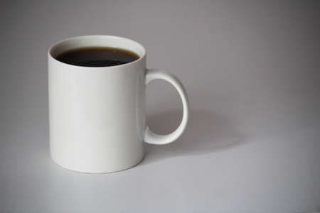 white cup of coffee for logo and design print on the office table background