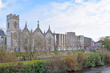 River Corrid passing through the beautiful city of Galway with a church and historic buildings on its left bank, Galway, Ireland