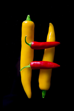 Chili peppers isolated on black background