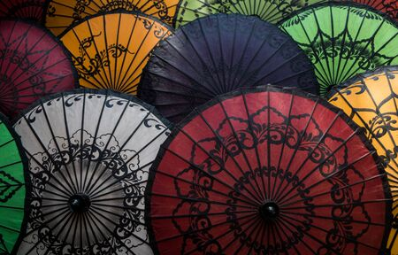 Handmade colorful umbrellas on street market in Bagan, Myanmar (Burma).