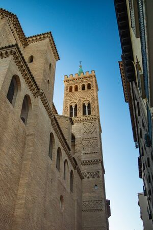 View of the Mudejar tower of the church of San Gil on Calle Don Jaime in Saragossa, Spain