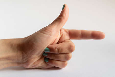 Hand in position imitating a gun or pointing on white background Stock Photo