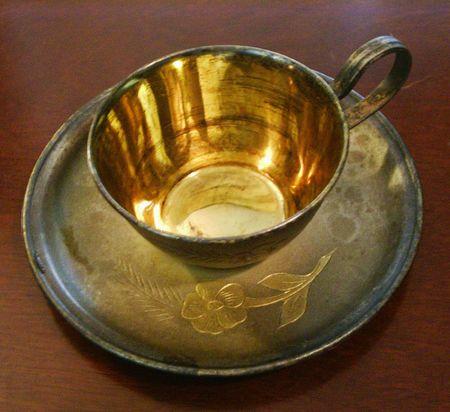 Zilver verguld koffie kop en schotel  Stockfoto