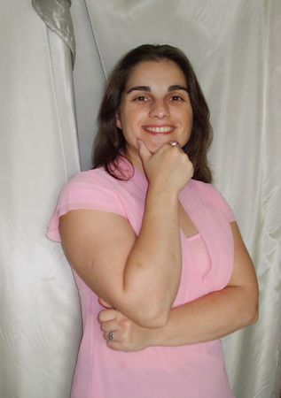chuckle: Smiling woman in pink blouse