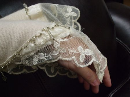 sleeve: Womans hand in a victorian lacy sleeve
