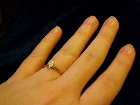 Hand wearing an engagement ring Stock Photo