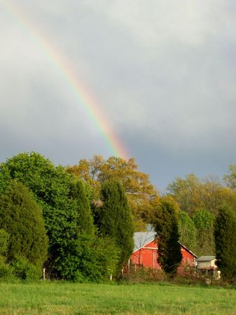 Landscape with a red barn and a rainbow photo
