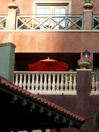 Orange umbrella on a balcony