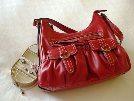 Small luggage - red handbag and a jewelry case Banque d'images
