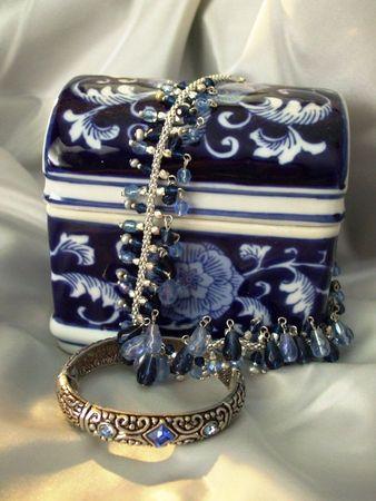 Blue ceramic jewelry box, blue necklace and ornate bracelet