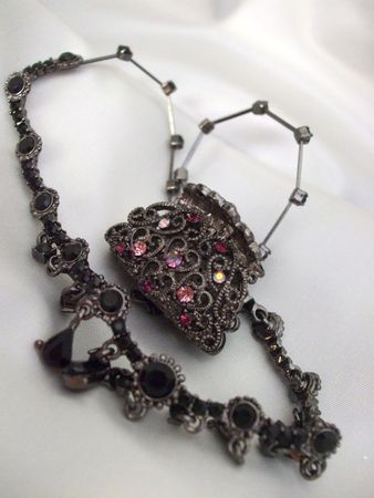 black onyx: Jeweled hair clip and black onyx necklace