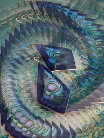 Abalone earrings against aquamarine glass - illusion