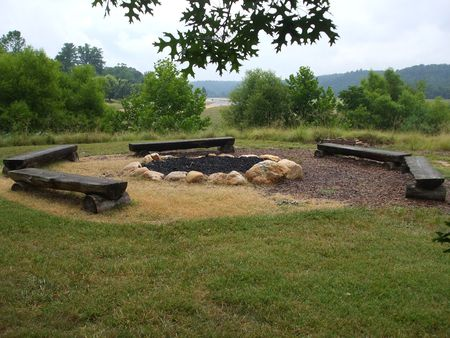 Primitive fire pit surrounded by benches