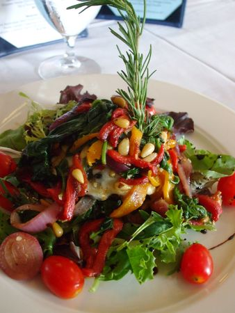 Salad decorated with a sprig of rosemary