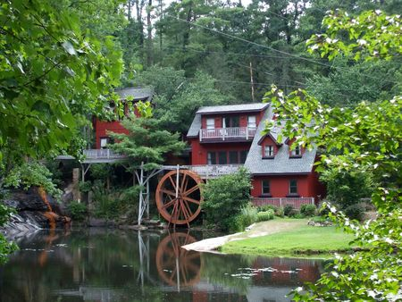 Historic building with a water wheel Imagens