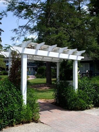 White arbor with climbing plants Banque d'images