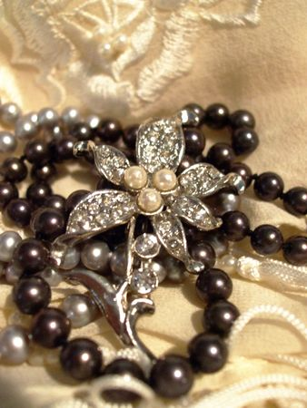 Silver flower pin and pearls photo
