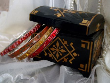 laquered: Black laquered box with bangle bracelets