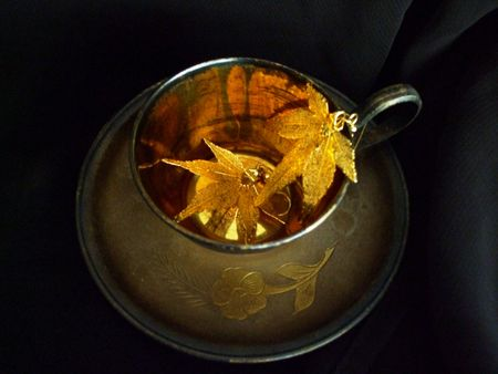 Gilded coffee cup with gold maple leaf earrings