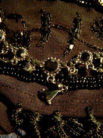 black onyx: Black onyx necklace on a black scarf Stock Photo
