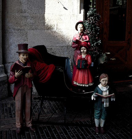 caroler: Christmas caroler figurines - photo with watercolor map applied