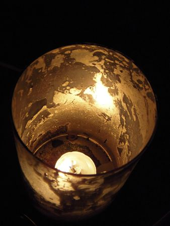 votive candle: Votive candle in a marble-textured holder