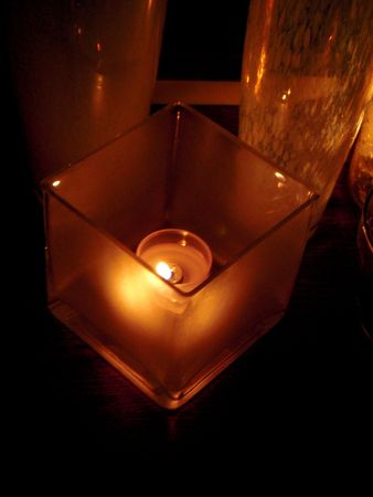 votive candle: Votive candle in a square holder