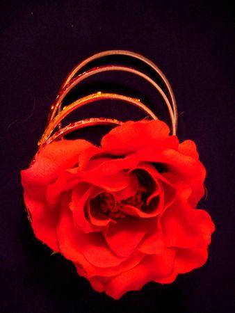 Red rose and bangle bracelets