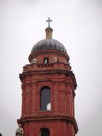 Bell tower of a red brick church Stock fotó