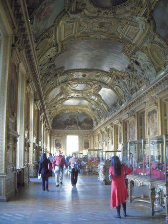 Paris, France, November 14, 2009 - visitors admiring the magnificent Galerie dAppollo at the Louvre in Paris