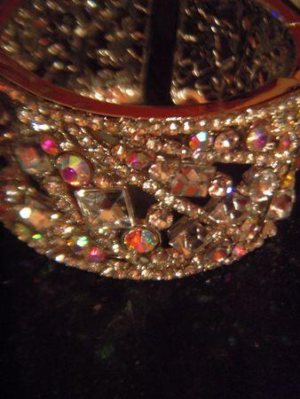 Rhinestone bracelet reflected in black surface