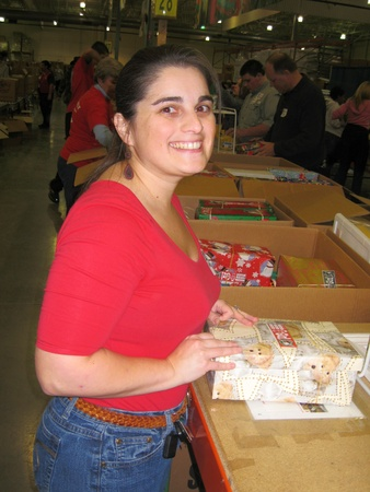 December 9, 2010 - Charlotte, NC - volunteer sorting through Operation Christmas Child shoe boxes Stock Photo - 8449456