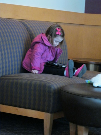 January 21, 2011 - Raleigh, NC - Young Starbucks visitor starting her morning with an iPad