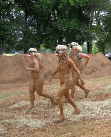 mud pit: Huntersville, NC - August 27, 2011 - Three Little Piggies emerging from the mud pit at the Warrior Dash