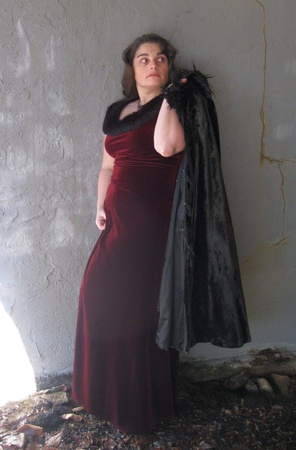 Woman in a burgundy gown and fur wrap photo
