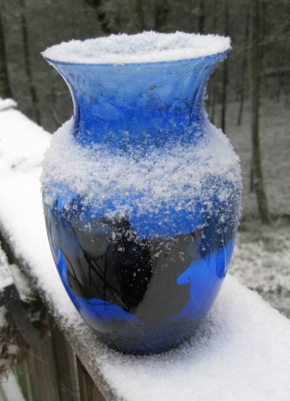 Blue vase in the snow