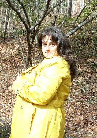 voluptuous women: Woman in a yellow coat Stock Photo