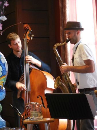 entertaining: September 27, 2015 - Asheville, NC - Musicians entertaining the patrons at the Red Stag Grille