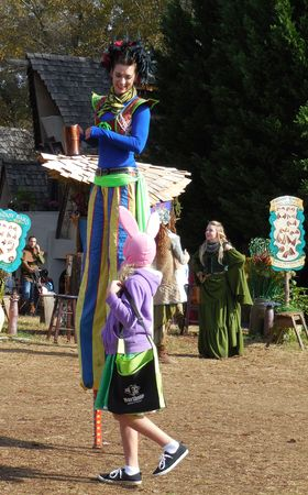 chats: October 31, 2015 - Huntersville, NC - A stilt walker chats with Renaissance Fest visitors Editorial