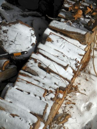 Firewood stack in the snow