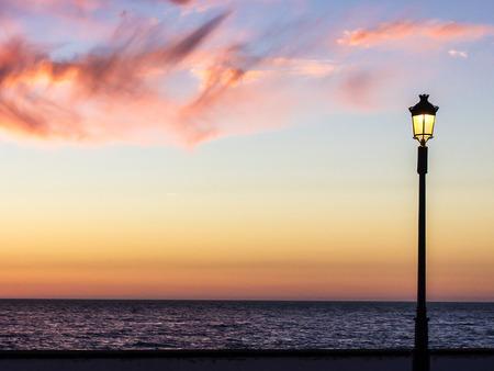 streetlight: streetlight watching the sunset
