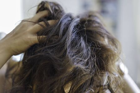 Head of unkempt woman. Itchy scalp or hair loss due to stress.