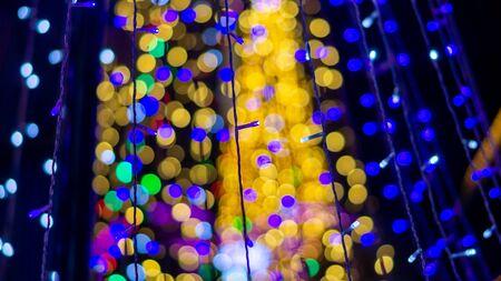 Christmas tree made with bokeh many colorful lights