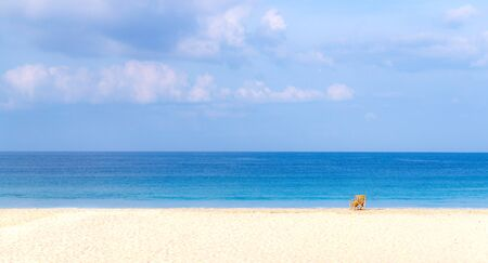 A single bamboo chair at the empty and exotic of Sin Htauk Beach, Myanmar. Imagens