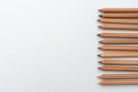 Diverse color skins tone pencils on a white canvas