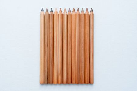 Top view of twelve different skin tone pencils on a white background Imagens