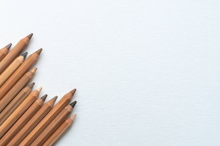 Pencil with diverse skin tone colors on a white canvas