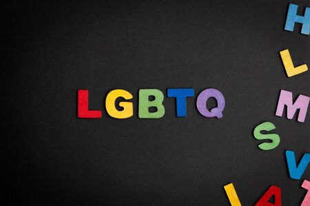 Colorful wooden letter forming the word LGBTQ and other color letters on the right side